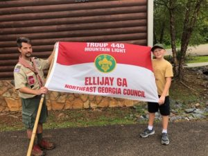 Two scouts holding troop flag